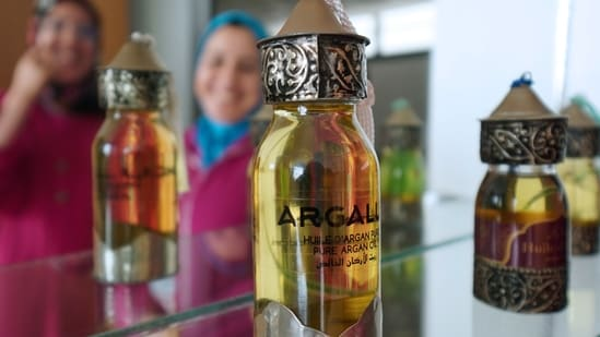 Argan oil bottles are displayed for sale inside the showroom of Women's Agricultural Cooperative Taitmatine, in Agadir, Morocco June 8, 2021. Picture taken June 8, 2021. (REUTERS)