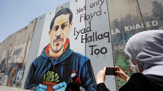 Israeli barrier with a mural depicting Eyad al-Halaq, an unarmed and autistic Palestinian who was shot dead by Israeli police in West Bank.(Reuters)