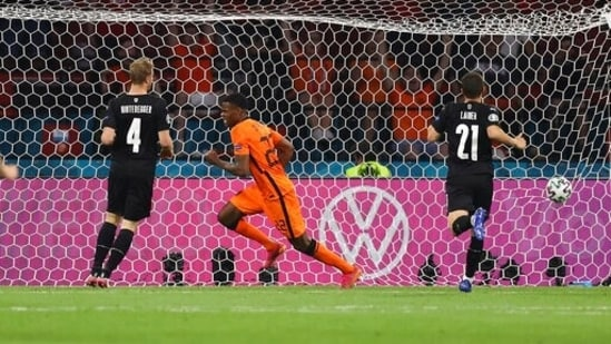Denzel Dumfries celebrates after scoring his side's 2nd goal during the Euro 2020 soccer championship group C match between Netherlands and Austria.