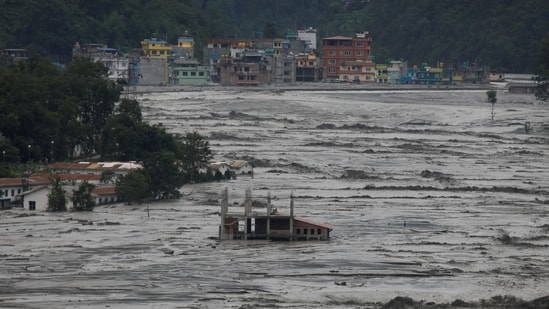 Partially submerged houses are seen as floodwater from the swollen Melamchi river enters the village in Sindhupalchok, on June 16. One of the epicentres of the 2015 earthquake, Sindhupalchok has been witnessing damages due to floods and landslides on an annual basis. With the onset of the monsoon in the Himalayan nation, incidents of floods and landslides are expected to rise further.(Navesh Chitrakar / REUTERS)