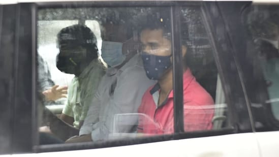 Arrested former Mumbai police officer Pradeep Sharma (centre).(HT Photo)