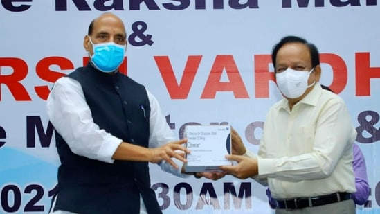 Union defence minister Rajnath Singh hands over to Health minister Harsh Vardhan the newly launched anti-COVID drug 2-DG, developed by DRDO, in New Delhi. (File Photo / PTI)