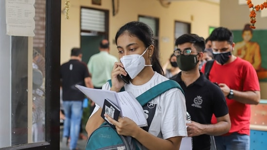Students and international travellers wait in a queue to complete paperwork before receiving the Covid-19 vaccine dose, at a dedicated vaccination center for international travellers in New Delhi on Wednesday. (File Photo / PTI)