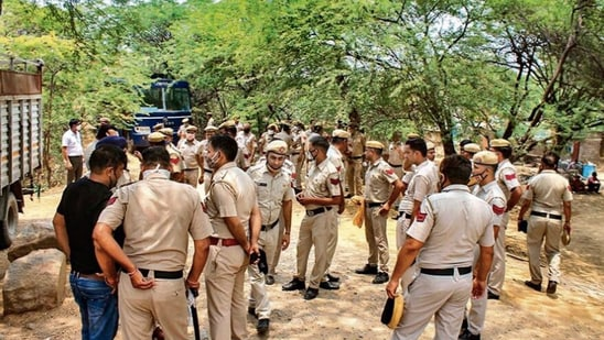 Police personnel at Khori Gaon village in Gurugram after the top court's directions on Thursday. PTI