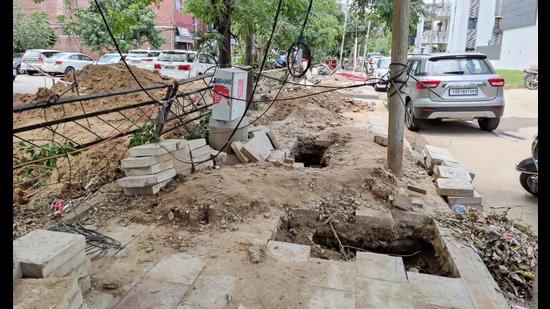 Trenches dug by the electricity department to lay down wires in a residential area at Sector 8. (HT Photo)
