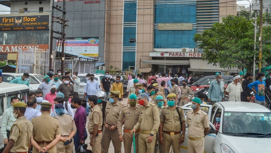 Agra: Police force deployed after many patients died during a mock drill at Paras hospital in Agra, Tuesday, June 8, 2021. (PTI)