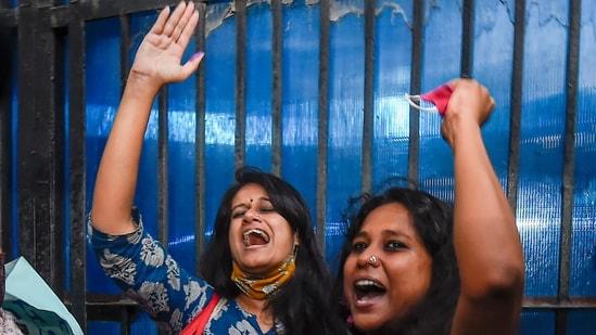 Student activists Natasha Narwal and Devangana Kalita outside Tihar after their release on Thursday. (PTI Photo/Kamal Singh)(PTI)