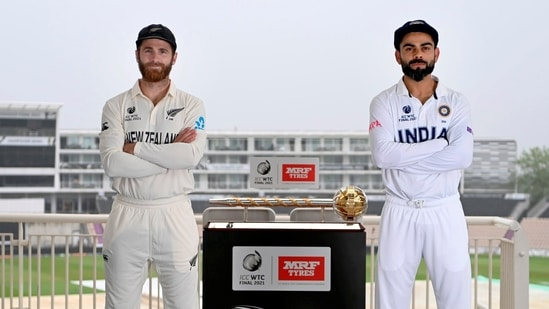 Indian cricket team captain Virat Kohli and his New Zealand counterpart Kane Williamson pose for a photograph with the World Test Championship (WTC) trophy ahead of their final match, in Southampton. (PTI)