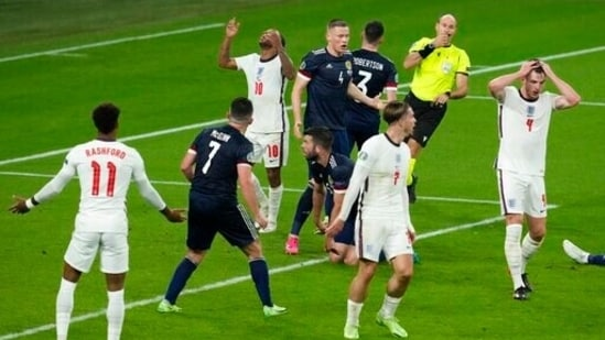 England players react after the referee's decision during the Euro 2020 soccer championship Group D match.(AP)