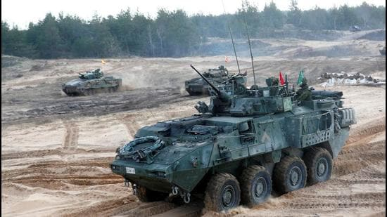 A Canadian Army LAV infantry fighting vehicle and Spanish Army Leopard 2 tanks take part in NATO enhanced Forward Presence battle group military exercise Crystal Arrow 2021 in Adazi, Latvia. (REUTERS)