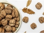 Walnuts contain good fats (13g/28g polyunsaturated fat and 2.5g/28g monounsaturated fat) that are an important part of a healthy diet. Although walnuts contain dietary fat, they won't necessarily make you gain body fat.(Unsplash)