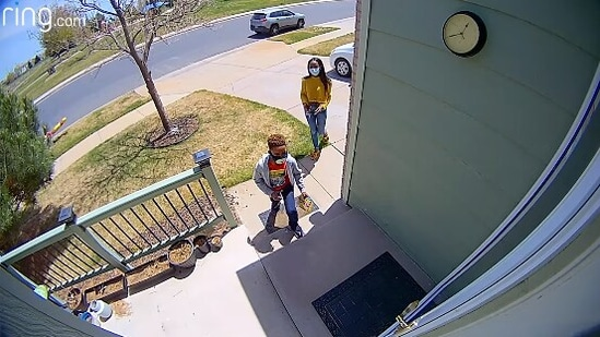 The image shows the mom and her son surprising their neighbour.(Facebook/@Ring)