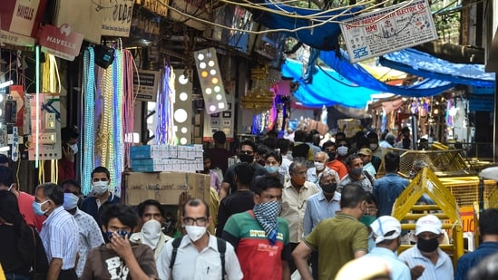 A gathering of people throng Chandni Chowk market that reopened after the Delhi government eased some restrictions in the ongoing Covid-19 induced lockdown in the national capital, on Thursday. (PTI)