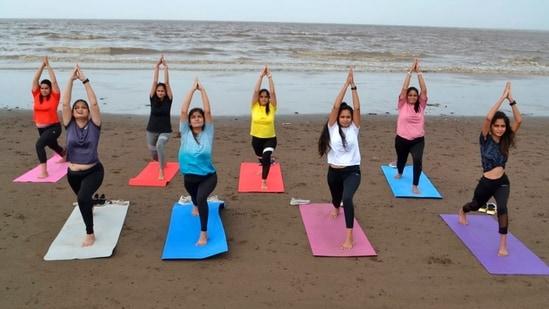 Surat: Women perform yoga on a beach ahead of International Yoga Day in Surat, Saturday, June 19, 2021. (PTI)