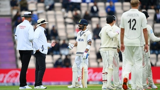 Virat Kohli in discussion with umpires.(Twitter)