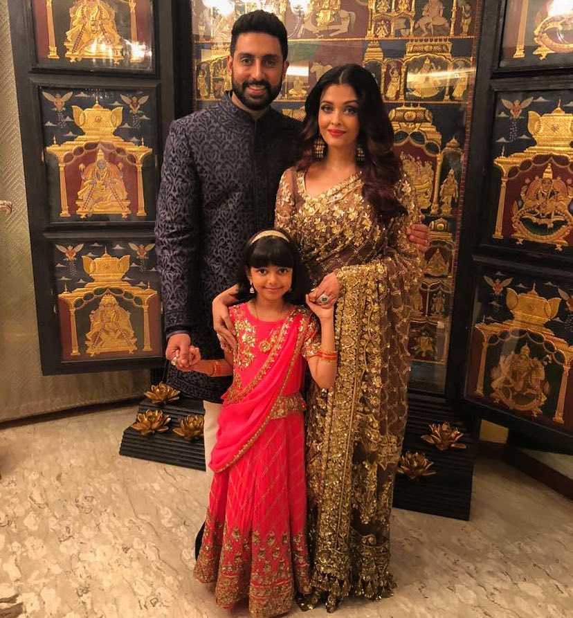 Abhishek Bachchan and Aishwarya Rai pose with their daughter Aaradhya at Jalsa.