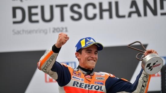 Repsol Honda's Marc Marquez celebrates with a trophy on the podium after winning the race REUTERS/Matthias Rietschel(REUTERS)