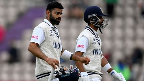 Virat Kohli and Ajinkya Rahane walk off the field after stumps on Day 2. (Getty Images)