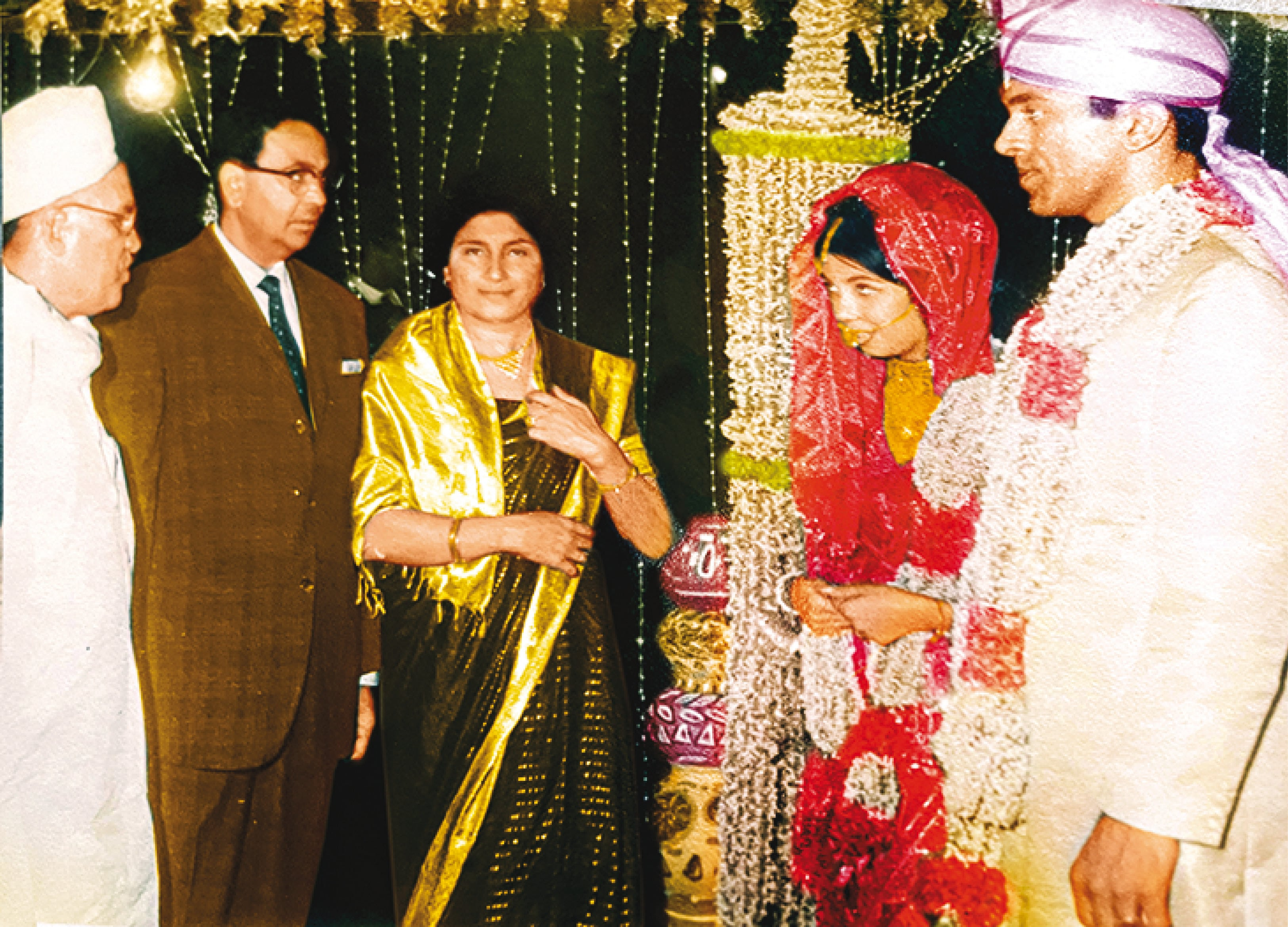 Ritu on the day of her wedding with her husband, Shashi Kumar, and her parents wearing the sari she had designed herself