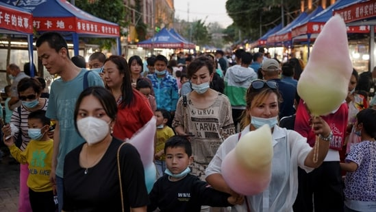 People walk in a night market during the May holidays tourist rush in the old city in Kashgar, Xinjiang.(Reuters)