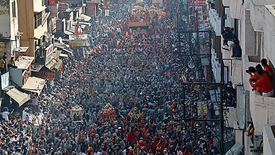 Devotees take part in a procession at the Kumbh fair.(Reuters)