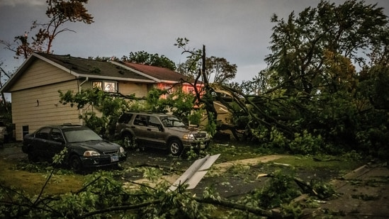 Fallen trees lay in front of a home after a tornado swept through the area in Woodridge, Ill., early Monday morning, June 21, 2021. (AP)