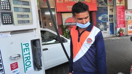 File photo: A fuel station attendant at a petrol station. (Ravi Kumar/Hindustan Times)