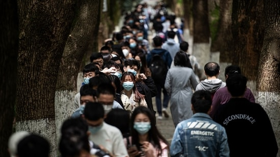 This photo taken on April 28, 2021 shows university students queueing to receive the China National Biotec Group (CNBG) Covid-19 coronavirus vaccine at a university in Wuhan, in China's central Hubei province.(AFP)