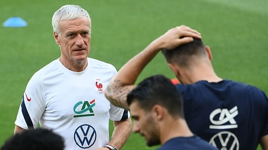 France's head coach Didier Deschamps (L) looks as his players during a training session at Nandor Hidegkuti in Budapest, on June 20, 2021, during the UEFA EURO 2020 European Football Championship.(AFP)