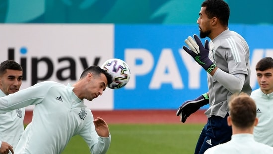 Spain's goalkeeper Robert Sanchez (top) and teammates take part in their MD-1 training session at Las Rozas near Madrid on June 22, 2021, the eve of their UEFA EURO 2020 Group E football match against Slovakia.(AFP)
