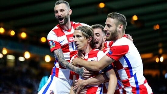 Luka Modric of Croatia celebrates with players after scoring a world-class goal against Scotland in their Euro 2020 game.(AP)