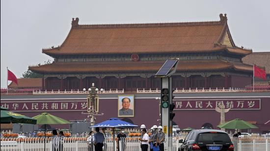 An official and security personnel get checked at an entrance to Tiananmen Square in Beijing on Wednesday. Chinese authorities have closed Beijing's central Tiananmen Square to the public, eight days ahead of a major celebration being planned to mark the 100th anniversary of the founding of the ruling Communist Party. (AP)