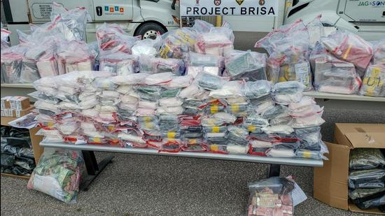 Over a 1,000kg of illegal drugs were seized, including 444kg of cocaine, 182kg of crystal meth, 427kg of marijuana and 300 oxycodone pills. (Toronto Police)