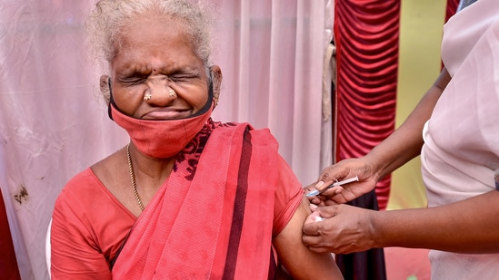 An elderly woman reacts as a health worker administers the Covid-19 vaccine.(PTI)
