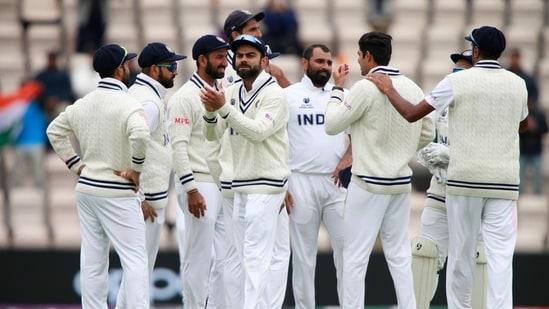 India's Mohammed Shami, third right, and teammates celebrate the dismissal of New Zealand's Ross Taylor.(AP)