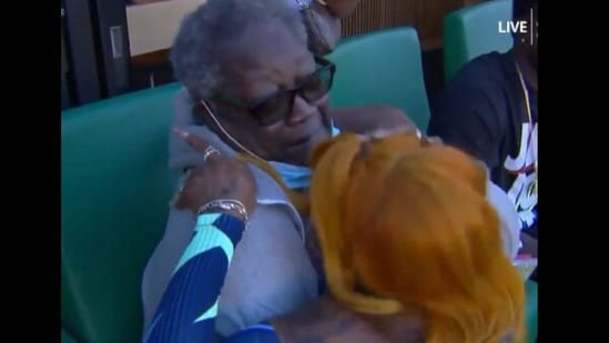 21-year-old Sha'Carri Richardson embraces her grandmother after qualifying for her first Olympic Games.(Reddit)