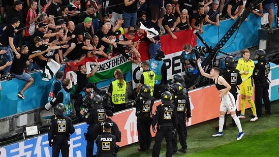Group F - Germany v Hungary - Football Arena Munich, Munich, Germany - June 23, 2021 Police stand in front of Hungary fans after the match (Pool via REUTERS)
