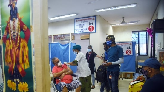 A healthcare worker inoculates a beneficiary with a dose of Covid-19 vaccine at Babasaheb Gawde Hospital, in Mumbai.(ANI File Photo)