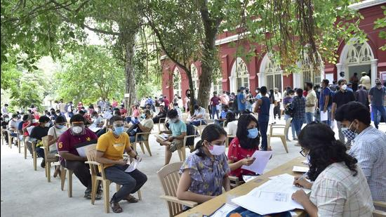 People register for Covid-19 vaccine dose during a special drive for those going abroad for education or employment in Bengaluru on Tuesday, June 22. (PTI)