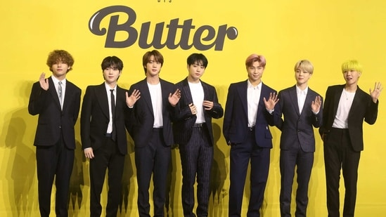 Members of South Korean K-pop boy band BTS pose for photographs during a press conference to promote their new single album 'Butter' in Seoul on May 21, 2021. (Photo by - / Dong-A Ilbo / AFP) / South Korea OUT(AFP)