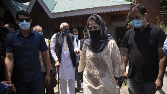 National Conference president Farooq Abdullah and Peoples Democratic Party president Mehbooba Mufti leave after a joint press conference of People's Alliance for Gupkar Declaration (PAGD) in Srinagar, Kashmir, on Tuesday. (AP)