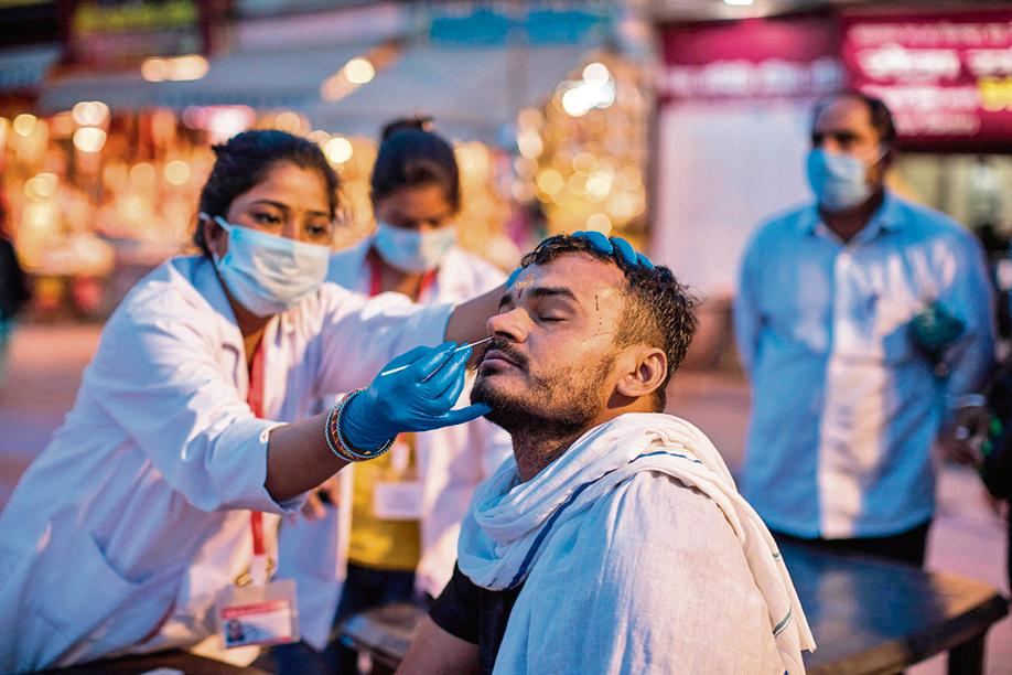 A health worker collects a nasal swab sample(AFP)
