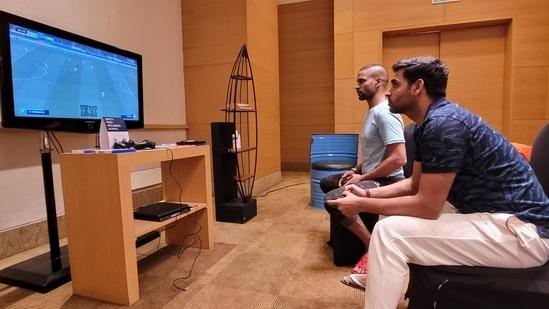 Shikhar Dhawan and Bhuvneshwar Kumar play PlayStation during quarantine in Mumbai(BCCI / Twitter)