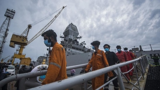 A total of 274 crew were reported missing on May 17 (261 from Barge P305 and 13 from Tug Varaprada). In picture - Crew members of Barge P305 coming out of INS Kochi after they were rescued.(HT Photo)