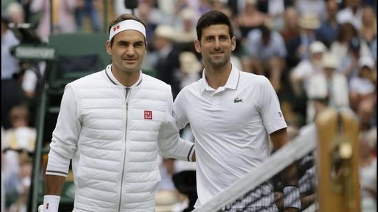 Roger Federer (left) and Novak Djokovic could face off in the final of the Wimbledon again this year. (AP)