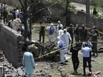 Security officials inspect the site of the explosion in Lahore