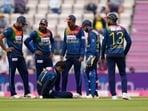 Sri Lanka's Binura Fernando sits on the pitch after trying to runout England's Dawid Malan during the third T20 international cricket match between England and Sri Lanka.(AP)