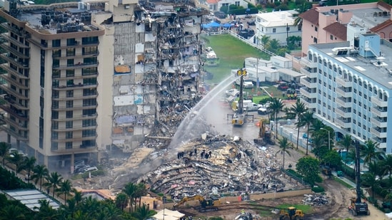 Rescue personnel work at the remains of the Champlain Towers South Condo in Surfside, Florida.(AP)