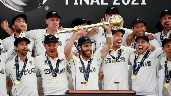New Zealand players celebrate after being handed the ICC Test Championship Mace, at the Rose Bowl in Southampton on Wednesday. New Zealand won the match by eight wickets.(ANI Photo/ICC Twitter)