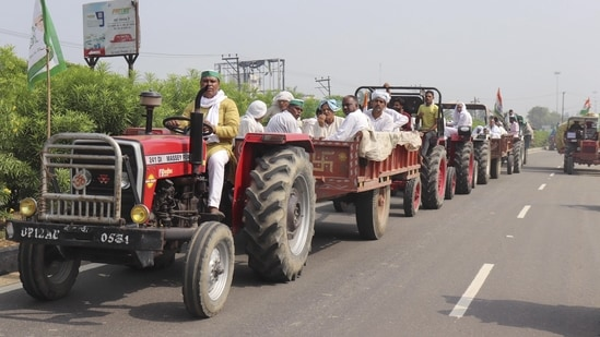 Meerut: Farmers, under the leadership of BKU leader Naresh Tikait, ride on tractor trolleys on their way to the Delhi-Ghazipur border near Delhi to join the ongoing protest against three farm reform laws, in Meerut, on Friday, June 25, 2021. (PTI)